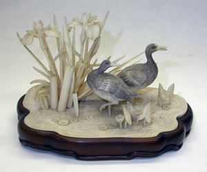 Image of Ivory Okimono, Birds and Iris Flowers on a Wooden Stand