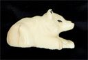 Image of Small Carved Dog Figurine