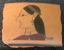 Image of Attic Black-Figure Outline Kylix (Drinking Cup) Fragment with Head of a Woman